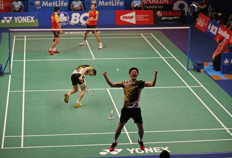 South Korea's Lee Yong-dae (R) and Yoo Yeon-seong react after their men's doubles semi-final match against China's Fu Haifeng and Zhang Nan at the Indonesia Open badminton championship. (Beawiharta/Reuters)