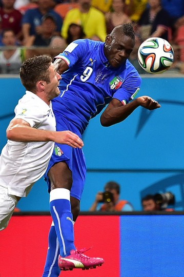 Italy's forward Mario Balotelli (R) heads the ball to score a goal as England's defender Gary Cahill defends during a Group D football match between England and Italy at the Amazonia Arena in Manaus during the 2014 FIFA World Cup. (Giuseppe Cacace/AFP-Getty Images)