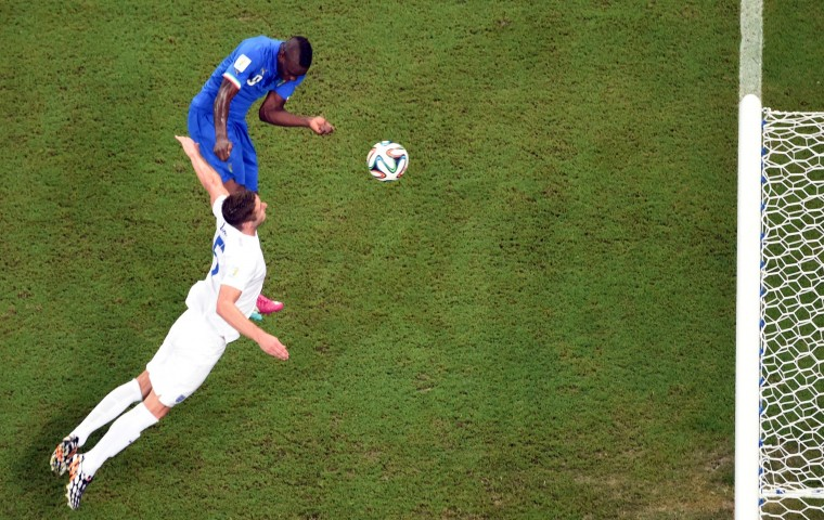 Italy's forward Mario Balotelli (L) heads and scores during a Group D football match between England and Italy at the Amazonia Arena in Manaus during the 2014 FIFA World Cup on June 14, 2014. (Francois Xavier Marit/Pool/AFP-Getty Images)
