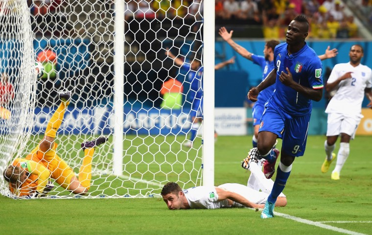 Mario Balotelli of Italy celebrates after scoring the second goal during the 2014 FIFA World Cup Brazil Group D match between England and Italy at Arena Amazonia in Manaus, Brazil. (Christopher Lee/Getty Images)