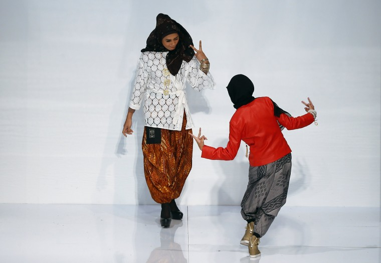 Models present creations by Afdlin Shauki during the Islamic Fashion Festival at Kuala Lumpur Fashion Week . The KL Fashion week will be held from June 18 to June 22. (Samsul Said/reuters)