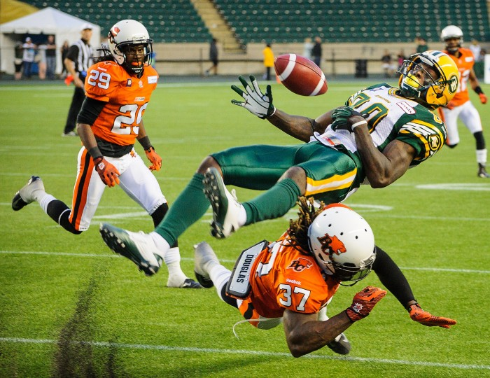Edmonton Eskimos receiver Nicholas Edwards bobbles a catch after being hit by British Columbia Lions Ronnie Yell during their CFL game at Commonwealth Stadium in Edmonton, Alberta, Canada. The Lions defeated the Eskimos 14-11. (Derek Leung/Getty Images)