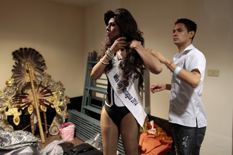 """A contestant gets ready backstage before the start of the """"Miss Gay Nicaragua 2014"""" competition in Managua. (Oswaldo Rivas/Reuters)"""