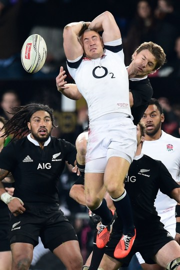 England's Mike Brown and New Zealand All Blacks' Beauden Barrett jump for the ball during the second rugby union test match in Dunedin. New Zealand won 28-27. (Marty Melville/AFP-Getty Images)