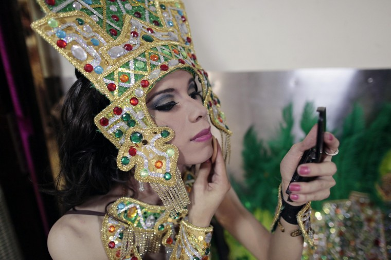 """A contestant puts on makeup backstage before the start of the """"Miss Gay Nicaragua 2014"""" competition in Managua. (Oswaldo Rivas/Reuters)"""