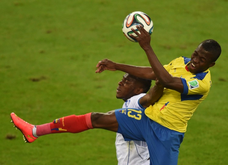 Ecuador's forward Enner Valencia (R) vies with an Honduran player during a Group E football match between Honduras and Ecuador at the Baixada Arena in Curitiba during the 2014 FIFA World Cup. (Christophe Simon/AFP-Getty Images)