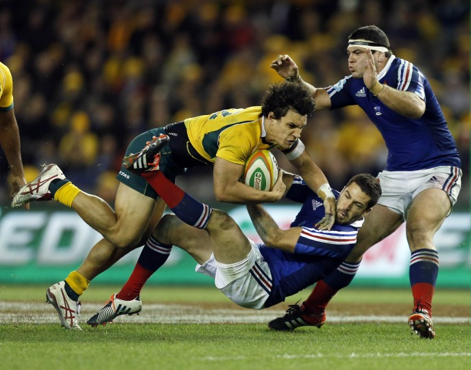 Australia Wallabies' Matt Toomua runs over France's defence during their second rugby union test match in Melbourne. (Jason Reed/Reuters)