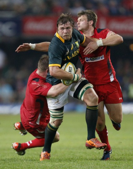 South Africa's Duane Vermeulen carries the ball into Wales' Ken Owens (L) and Dan Biggar during their rugby test match in Durban, South Africa. (Rogan Ward/Reuters)