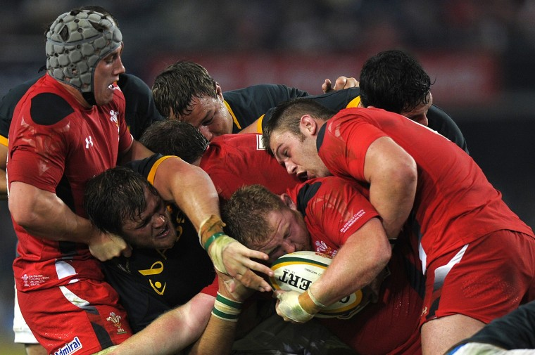 Wales and South African players scrum for the ball during the Rugby test match between South Africa and Wales at Kings Stadium in Durban, South Africa. (Gianluigi Guercia/AFP-Getty Images)