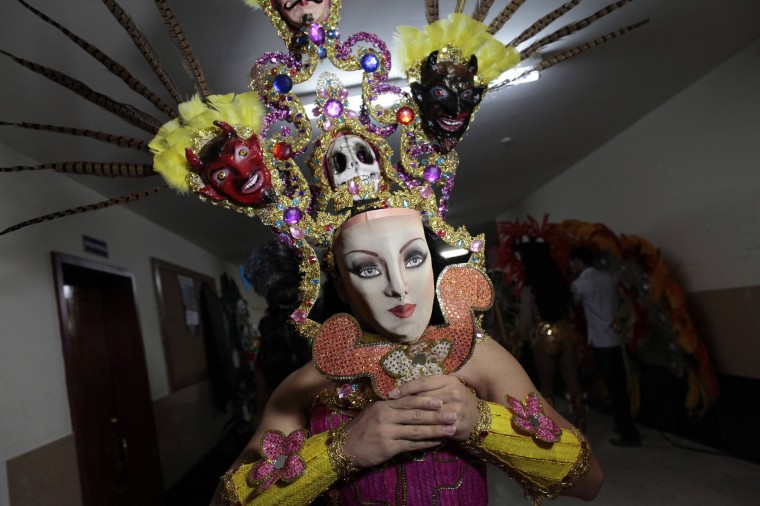 """A contestant dressed backstage before the start of the """"Miss Gay Nicaragua 2014"""" competition in Managua. (Oswaldo Rivas/Reuters)"""