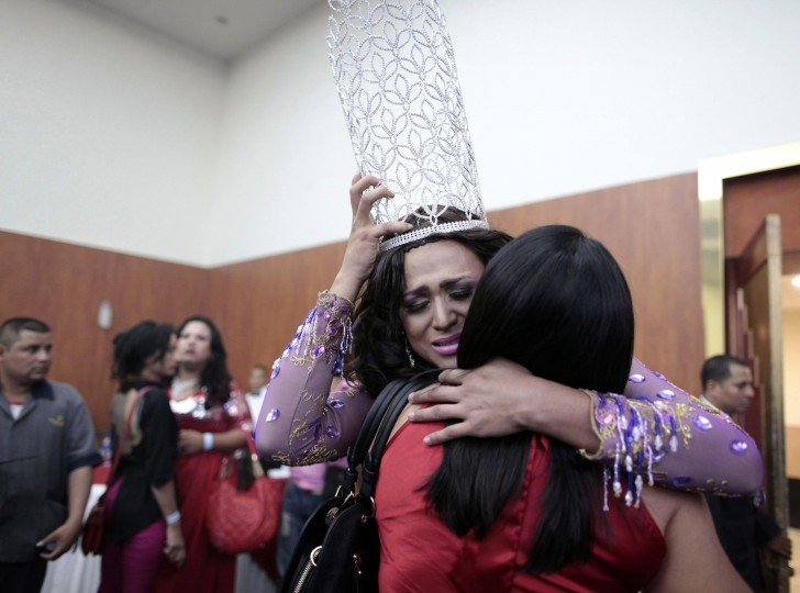 """Jairo Davila, also known as America Gisel, embraces her mother after being crowned """"Miss Gay Nicaragua 2014"""" during the pageant in Managua. (Oswaldo Rivas/Reuters)"""