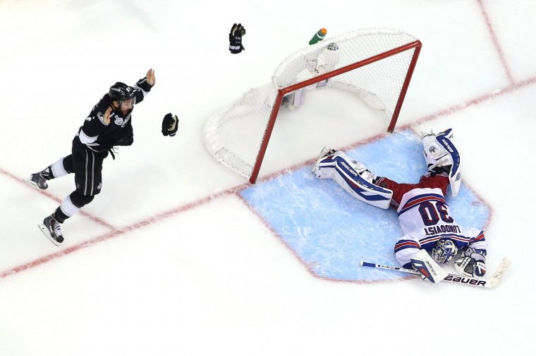 Los Angeles Kings Alec Martinez celebrates after scoring the game-winning goal in double overtime against goaltender Henrik Lundqvist of the New York Rangers to give the Kings the 3-2 victory in Game Five of the 2014 Stanley Cup Final at the Staples Center. (Bruce Bennett/Getty Images)