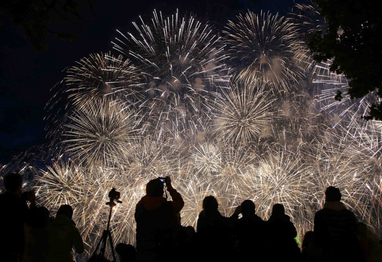 People watch a laser and fireworks show over the Neva River and the Peter and Paul Fortress in St. Petersburg. The show marks the annual school leavers day. (Alexander Demianchuk/Reuters)
