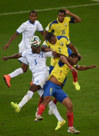 Honduras' defender Maynor Figueroa (L) vies with Ecuador's defender Jorge Guagua (C) during a Group E football match between Honduras and Ecuador at the Baixada Arena in Curitiba during the 2014 FIFA World Cup. (Christophe Simon/AFP-Getty Images)