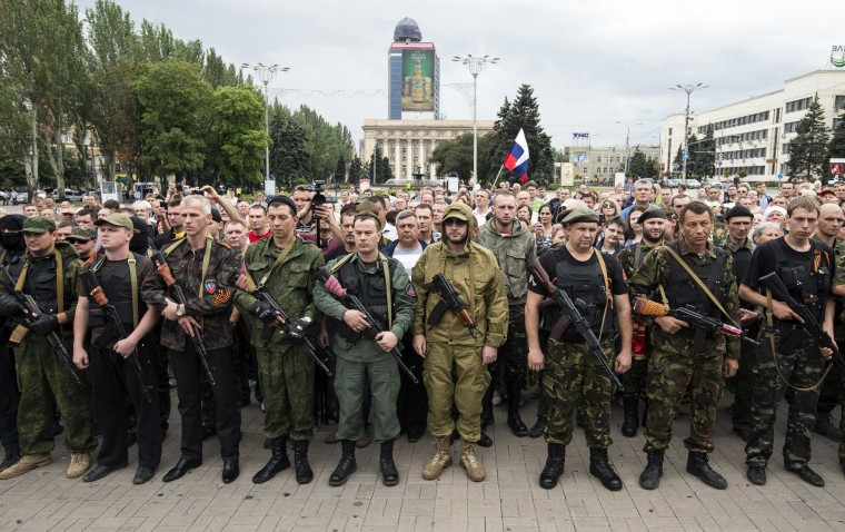 Armed pro-Russian separatists of the self-proclaimed Donetsk People's Republic pledge an oath during a ceremony in the city of Donetsk. Ukrainian President Petro Poroshenko on Friday ordered a seven-day ceasefire in the fight against pro-Russian separatists, but also warned them they could face death if they did not use the time to put down their guns. (Shamil Zhumatov/Reuters)