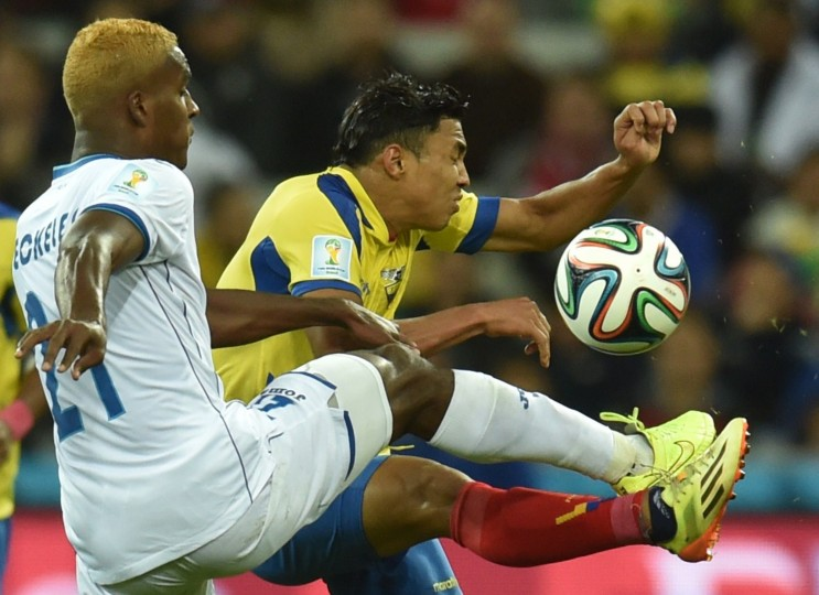 Honduras' defender Brayan Beckeles (L) controls the ball during a Group E football match between Honduras and Ecuador at the Baixada Arena in Curitiba during the 2014 FIFA World Cup. (Rodrigo Arangua/AFP-Getty Images)