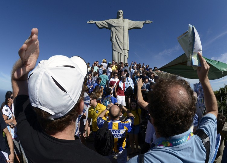 Argetinians cheer for their fooball team as they visit the statue of Christ the Redeemer atop Corcovado hill in Rio de Janeiro, Brazil. (Juan Mabrowata/AFP-Getty Images)