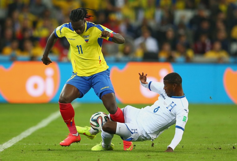 Juan Carlos Garcia of Honduras tackles Felipe Caicedo of Ecuador during the 2014 FIFA World Cup Brazil Group E match between Honduras and Ecuador at Arena da Baixada in Curitiba, Brazil. (Julian Finney/Getty Images)