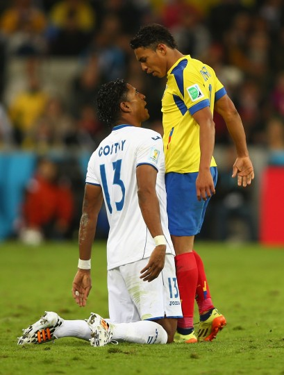 Carlo Costly of Honduras clashes with Jefferson Montero of Ecuador during the 2014 FIFA World Cup Brazil Group E match between Honduras and Ecuador at Arena da Baixada in Curitiba, Brazil. (Clive Rose/Getty Images)