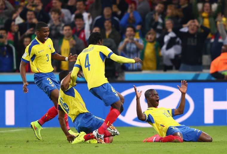 Enner Valencia of Ecuador (R) celebrates after scoring his team's second goal with Frickson Erazo (L), Antonio Valencia (2nd L) and Juan Carlos Paredes (2nd R) during the 2014 FIFA World Cup Brazil Group E match between Honduras and Ecuador at Arena da Baixada in Curitiba, Brazil. (Jamie Squire/Getty Images)
