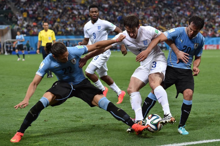 England's defender Leighton Baines (Center) vies with Uruguay's defender Martin Caceres and Uruguay's midfielder Alvaro Gonzalez during a Group D football match between Uruguay and England at the Corinthians Arena in Sao Paulo during the 2014 FIFA World Cup on June 19, 2014. (Nelson Almeida/Getty Images)