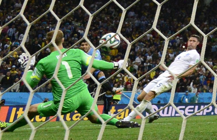 Uruguay's forward Luis Suarez (Center) scores against England's goalkeeper Joe Hart (Left) during a Group D football match between Uruguay and England at the Corinthians Arena in Sao Paulo during the 2014 FIFA World Cup on June 19, 2014. (Daniel Garcia/Getty Images)