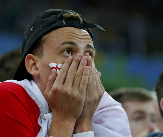 An England fan reacts during the team's 2014 World Cup Group D soccer match against Uruguay at the Corinthians arena in Sao Paulo June 19, 2014. (Laszlo Balogh/Reuters photo)