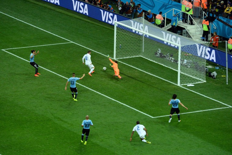 Wayne Rooney of England scores his team's first goal past Fernando Muslera of Uruguay during the 2014 FIFA World Cup Brazil Group D match between Uruguay and England at Arena de Sao Paulo on June 19, 2014 in Sao Paulo, Brazil. (Matthias Hangst/Getty Images)