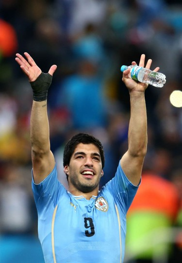 Luis Suarez of Uruguay acknowledges the fans after defeating England 2-1 during the 2014 FIFA World Cup Brazil Group D match between Uruguay and England at Arena de Sao Paulo on June 19, 2014 in Sao Paulo, Brazil. ( Julian Finney/Getty Images)