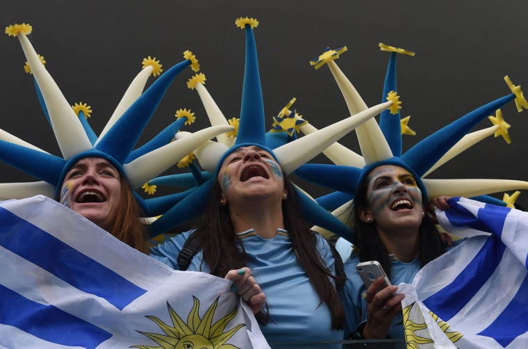 Uruguayan fans cheer before the start of a Group D football match between Uruguay and England at the Corinthians Arena in Sao Paulo during the 2014 FIFA World Cup on June 19, 2014. (Luis Acosta/Getty Images)