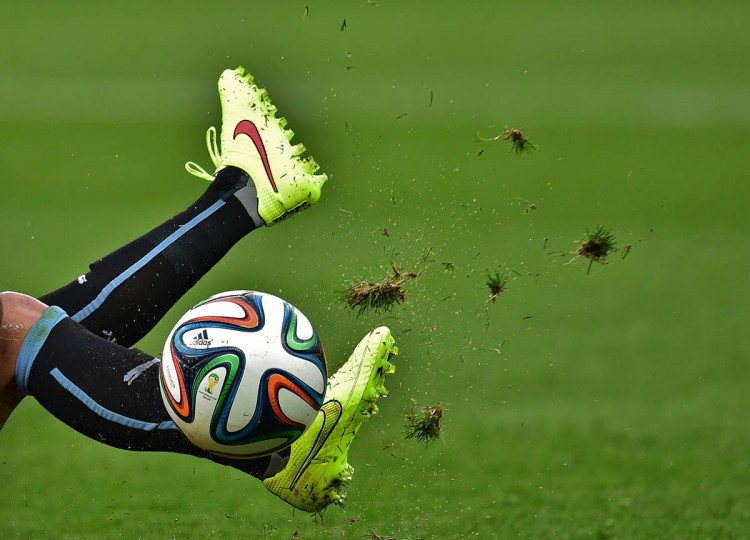 A Uruguayan player kicks the ball during the Group D football match between Uruguay and England at the Corinthians Arena in Sao Paulo on June 19, 2014, during the 2014 FIFA World Cup. (Nelson Almeida/Getty Images)