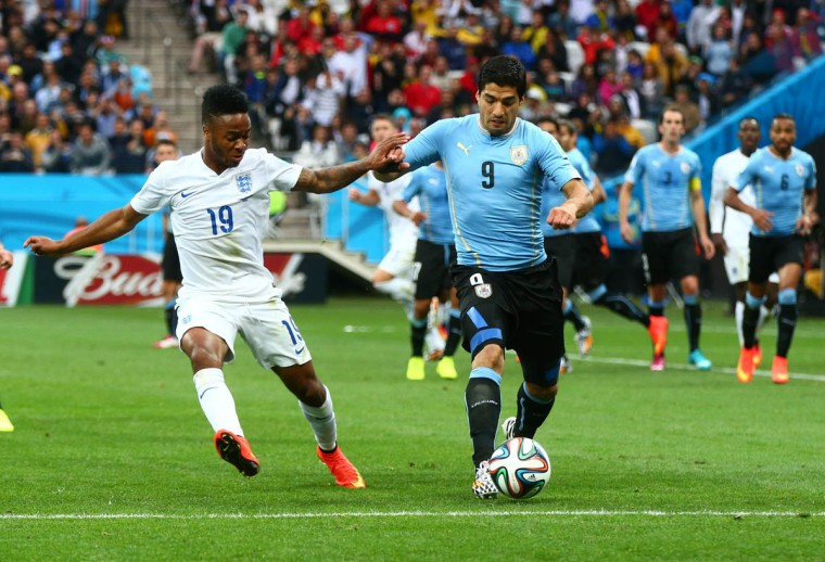 Uruguay forward Luis Suarez (9) controls the ball against England forward Raheem Sterling (19) in the first half during the 2014 World Cup at Arena Corinthians. (Mark J. Rebilas/USA TODAY Sports)