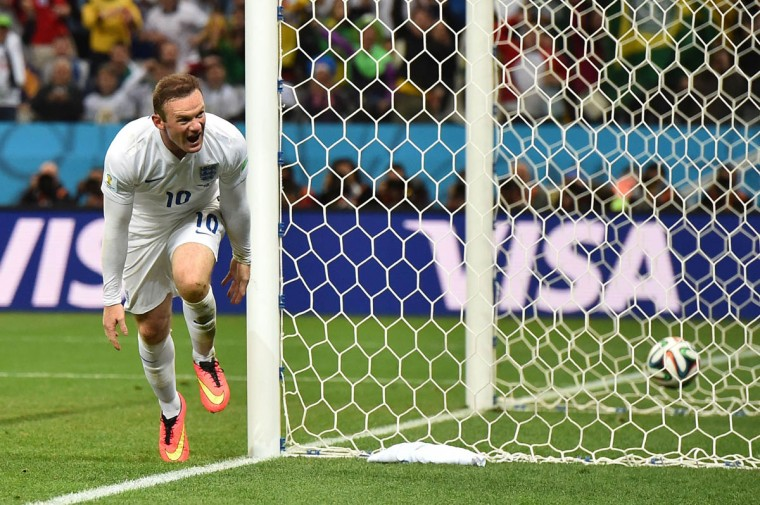 England's forward Wayne Rooney celebrates scoring during the Group D football match between Uruguay and England at the Corinthians Arena in Sao Paulo on June 19, 2014, during the 2014 FIFA World Cup. (Ben Stansall/Getty Images)