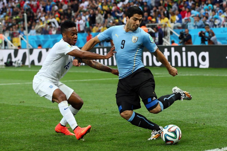Raheem Sterling of England and Luis Suarez of Uruguay compete for the ball during the 2014 FIFA World Cup Brazil Group D match between Uruguay and England at Arena de Sao Paulo on June 19, 2014 in Sao Paulo, Brazil. (Kevin C.Cox/Getty Images)