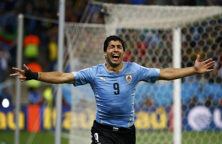 Uruguay's Luis Suarez celebrates after scoring his team's second goal against England during their 2014 World Cup Group D soccer match at the Corinthians arena in Sao Paulo June 19, 2014. (Tony Gentile/Reuters photo)
