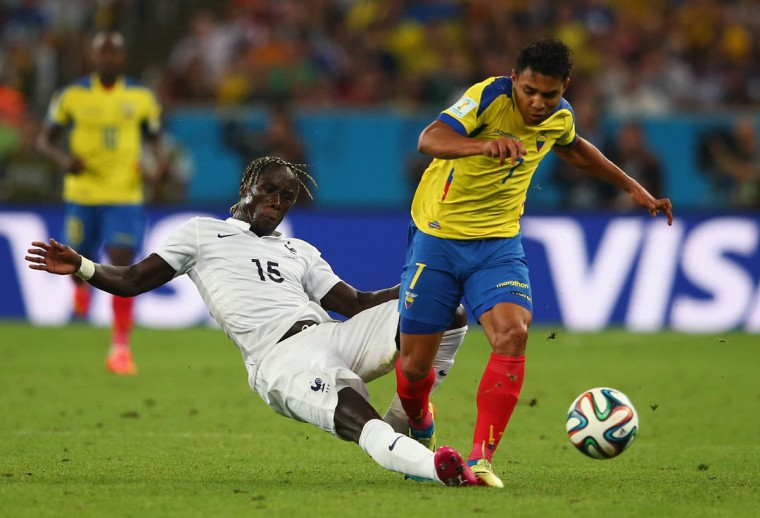 Bacary Sagna of France tackles Jefferson Montero of Ecuador during the 2014 FIFA World Cup Brazil Group E match between Ecuador and France at Maracana on June 25, 2014 in Rio de Janeiro, Brazil. (Julian Finney/Getty Images)