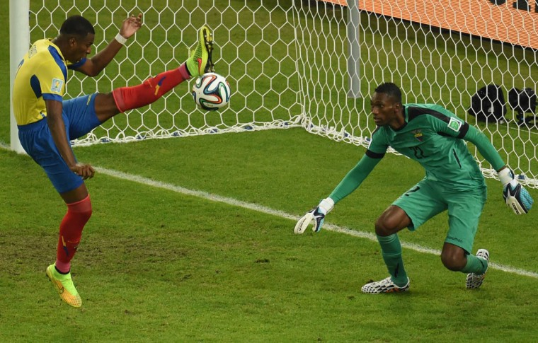 Ecuador's defender Frickson Erazo (Left) tries to clear the ball as Ecuador's goalkeeper Alexander Dominguez defends the goal during the Group E football match between Ecuador and France at the Maracana Stadium in Rio de Janeiro during the 2014 FIFA World Cup on June 25, 2014. (William West/Getty Images)