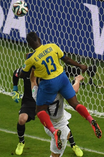 Ecuador's forward Enner Valencia tries to head the ball into the goal as and France's defender Lucas Digne (Center) defends during the Group E football match between Ecuador and France at the Maracana Stadium in Rio de Janeiro during the 2014 FIFA World Cup on June 25, 2014. (William West/Getty Images)