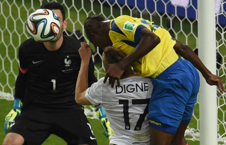 Ecuador's forward Enner Valencia (Right) attempts a header on the goal as France's goalkeeper and captain Hugo Lloris (Left), France's defender Lucas Digne (Center) defend during the Group E football match between Ecuador and France at the Maracana Stadium in Rio de Janeiro during the 2014 FIFA World Cup on June 25, 2014. (William West/Getty Images)