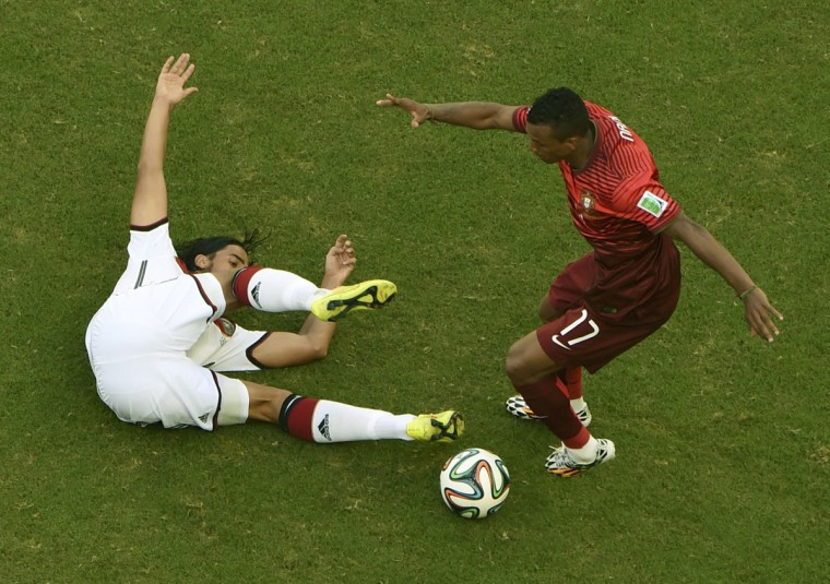 Germany's Sami Khedira fights for the ball with Portugal's Nani during their 2014 World Cup Group G soccer match at the Fonte Nova arena in Salvador on June 16, 2014. (REUTERS/Francois Marit/Pool)