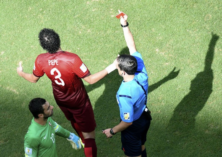 Referee Milorad Mazic of Serbia shows the red card to Portugal's Pepe during the 2014 World Cup Group G soccer match. (REUTERS/Francois Marit/Pool)