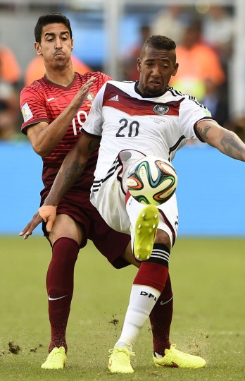 Germany's Jerome Boateng (20) kicks the ball next to Portugal's Andre Almeida during their 2014 World Cup Group G soccer match at the Fonte Nova arena in Salvador, June 16, 2014. (REUTERS/Dylan Martinez)