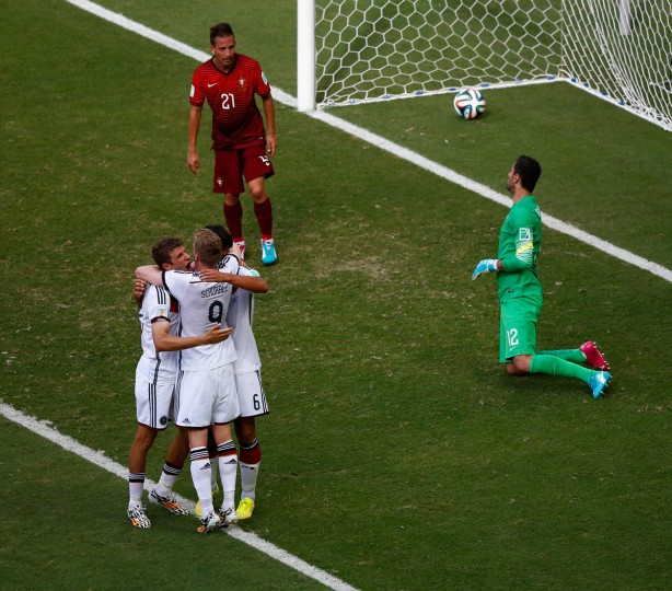 Thomas Mueller of Germany celebrates scoring his team's fourth goal and completing his hat trick with Andre Schuerrle and Sami Khedira as Joao Pereira and goalkeeper Rui Patricio of Portugal look on during the 2014 FIFA World Cup Brazil Group G match between Germany and Portugal at Arena Fonte Nova on June 16, 2014 in Salvador, Brazil. (Photo by Matthew Lewis/Getty Images)