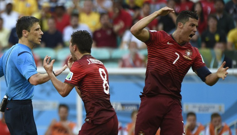 Portugal's forward and captain Cristiano Ronaldo and Portugal's midfielder Joao Moutinho argue with Serbian referee Milorad Mazic for a penalty during the Group G football match between Germany and Portugal at the Fonte Nova Arena in Salvador during the 2014 FIFA World Cup on June 16, 2014. (ODD ANDERSEN/AFP/Getty Images)