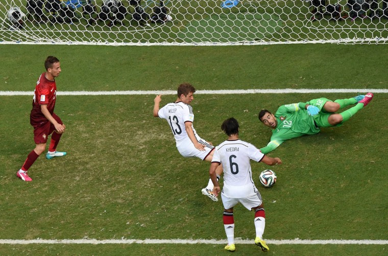 Germany's forward Thomas Mueller (C) is watched by Germany's midfielder Sami Khedira (second from right) as he scores his third goal past Portugal's goalkeeper Rui Patricio (right) during the Group G football match between Germany and Portugal at the Fonte Nova Arena in Salvador on June 16, 2014, during the 2014 FIFA World Cup. (FRANCOIS XAVIER MARIT/AFP/Getty Images)