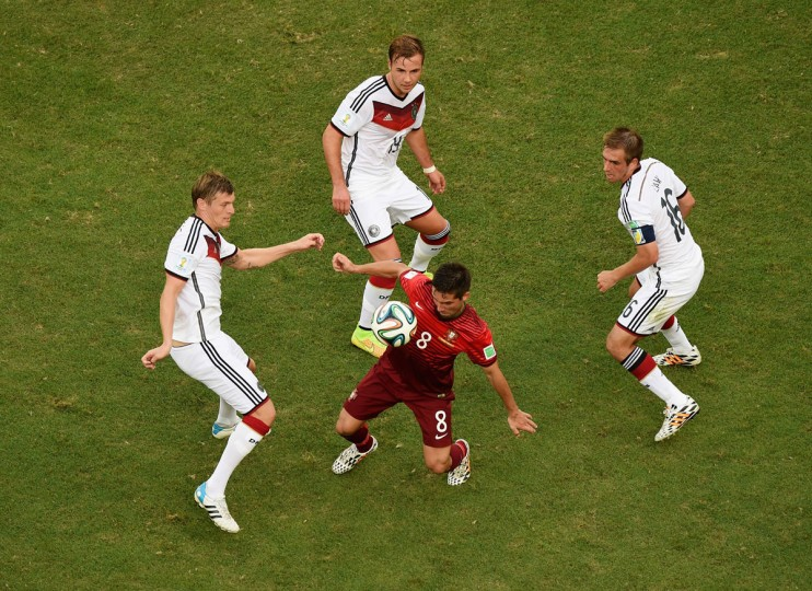 Joao Moutinho of Portugal takes on Toni Kroos of Germany, Mario Goetze and Philipp Lahm during the 2014 FIFA World Cup Brazil Group G match between Germany and Portugal at Arena Fonte Nova on June 16, 2014 in Salvador, Brazil. (Photo by Francois Xavier Marit - Pool/Getty Images)