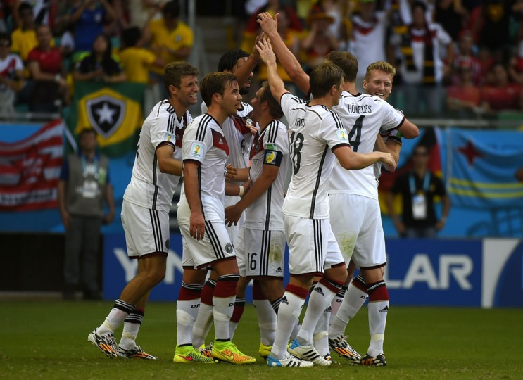 Germany forward Thomas Mueller (left) celebrates with teammates after scoring his third goal during the Group G football match between Germany and Portugal at the Fonte Nova Arena in Salvador on June 16, 2014, during the 2014 FIFA World Cup. (FABRICE COFFRINI/AFP/Getty Images)