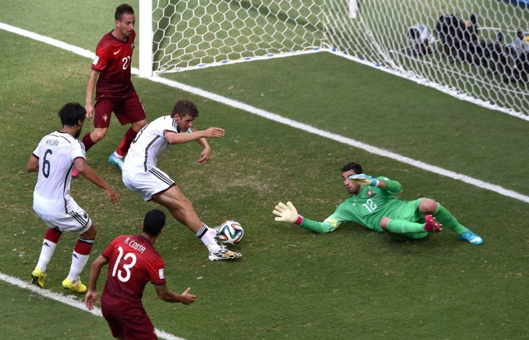 Germany's forward Thomas Mueller scores on Portugal's Rui Patricio. (DIMITAR DILKOFF/AFP/Getty Images)