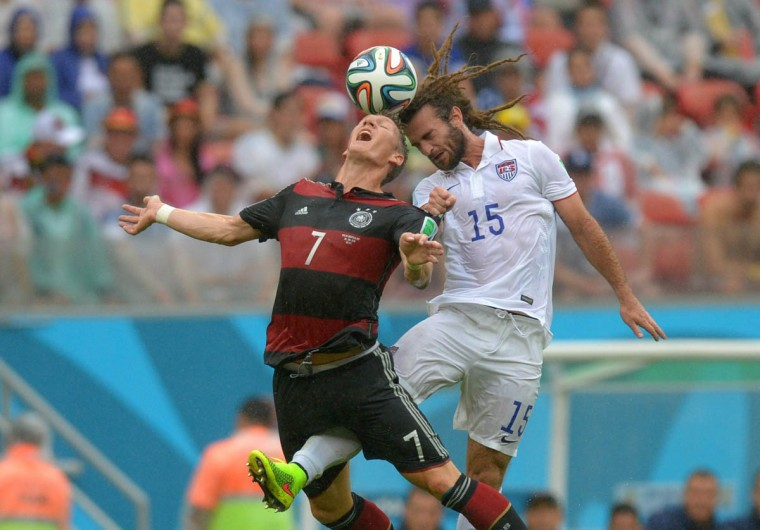 Kyle Beckerman of Team USA and Bastian Schweinsteiger, left, of Germany vie for the ball during the FIFA World Cup at Arena Pernambuco in Recife, Brazil, on June 26, 2014. (Thomas Eisenhuth/MCT)