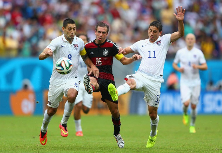 Philipp Lahm of Germany is challenged by Clint Dempsey (Left) and Alejandro Bedoya of the United States during the 2014 FIFA World Cup Brazil group G match between the United States and Germany at Arena Pernambuco on June 26, 2014 in Recife, Brazil. (Michael Steele/Getty Images)
